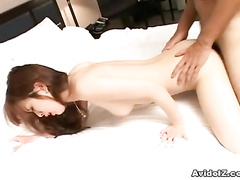Seduced Asian lass fucked in the bedroom in doggy style