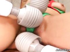 Lewd Asian girl convulses from three vibrators