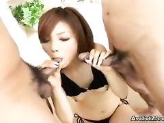 Black lingerie Asian girl doing double blowjob