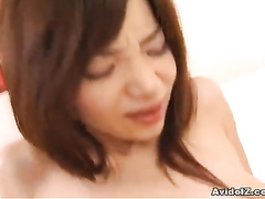 Busty Asian looks at the rod that slides into nub