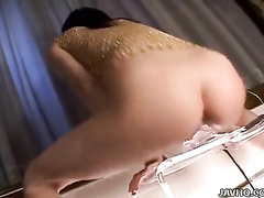 Solo girl is riding the big dildo toy before cam