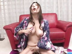 Busty Asian plays with a toy with mouthful following