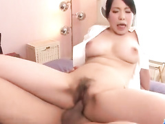 Horny Asian nurse plays with two hard ramrods