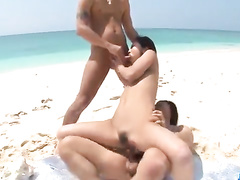 Girl on the beach gets humped by two members