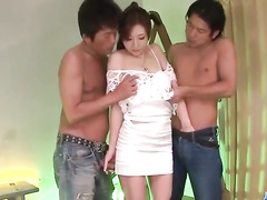 Japanese milf masturbated by two young males