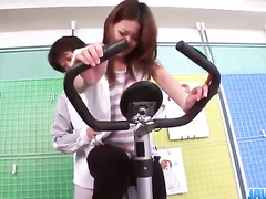 Asian guy hotly excites while helping hot chick doing exercises