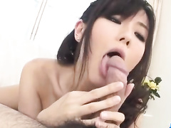 Exciting young Asian babe in sexy white bodysuit gets hotly kissed