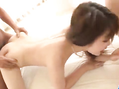Petite brunette babe is sitting on couch and hotly masturbating cunt