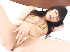 Long haired brunette excitingly fondles her self with vibrator