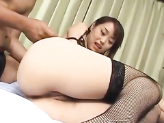 Cutie Asian girlie gets fondled and sucks two dicks