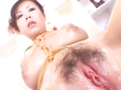 Brown haired Asian babe in fishnet stockings enjoys passionate fuck