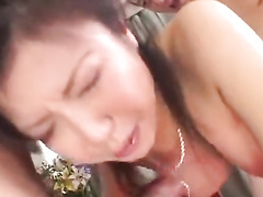 Beautiful Japanese chick pleasures hot threesome fuck with two guys