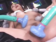 Japanese chick gets drilled with four vibrator toys