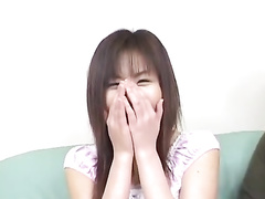Adorably cute Asian beauty gets seduced and excited with sex toy