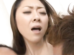 Slender hot young Japanese chick enjoys fucking with two guys
