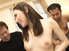 Asian chick gets fondled by group of fuckers and sucks two cocks