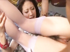 Awesome Japanese chick is doing deep blowjob to two fuckers