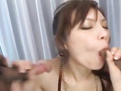 Charming young Japanese cutie enjoys sucking two dicks