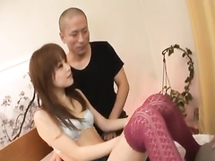 Beautiful Japanese chick is pleasuring threesome fuck with two dudes