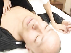 Horny young Japanese chick is undressing bald boyfriend
