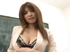Redhead Japanese teacher chick hotly strokes pussy in classroom
