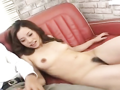 Horny brown haired beauty excitingly fondles her boobs and poses