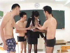 Beautiful Japanese teacher satisfies four naughty student guys
