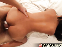 Busty Asian girl is hotly riding white cock and passionately fucking in doggy pose
