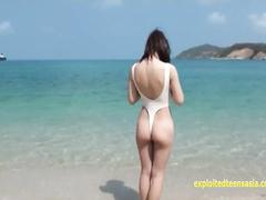 Naughty Japanese teen chick Mirai Arisa pulls her bikini to show cameltoe